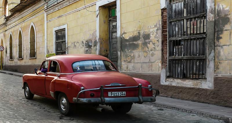 Red Car on Havana Cobblestone