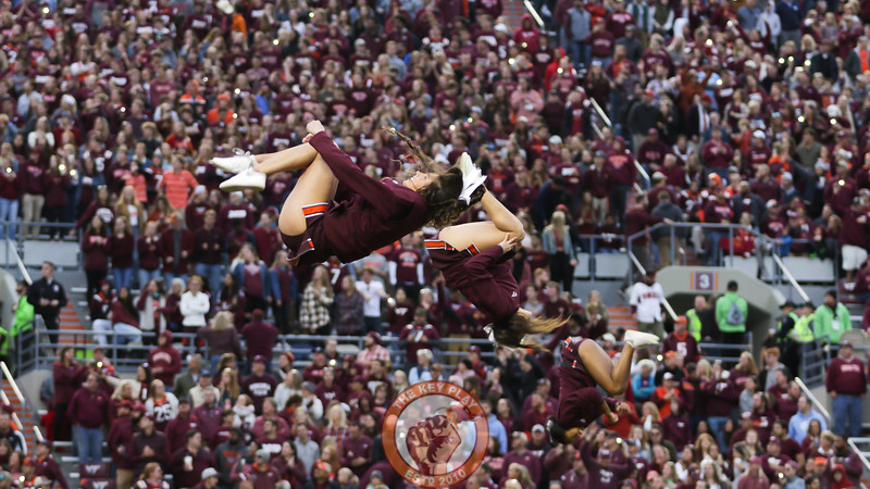 The Virginia Tech cheerleaders flip through the air during the media timeout before the fourth quarter. (Mark Umansky/TheKeyPlay.com)