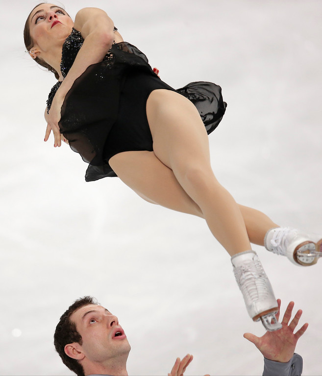 . Marissa Castelli and Simon Shnapir of the United States compete in the pairs free skate figure skating competition at the 2014 Winter Olympics, Wednesday, Feb. 12, 2014, in Sochi, Russia. (AP Photo/Bernat Armangue)
