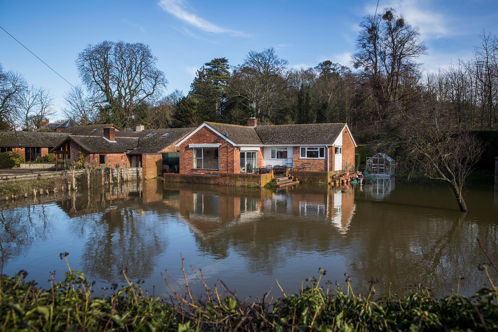 . Floodwater surrounds a house on February 13, 2014 in Severn Stoke, Worcestershire, England. The Environment Agency has issued flood warnings for dozens of areas along the River Severn. (Photo by Rob Stothard/Getty Images)