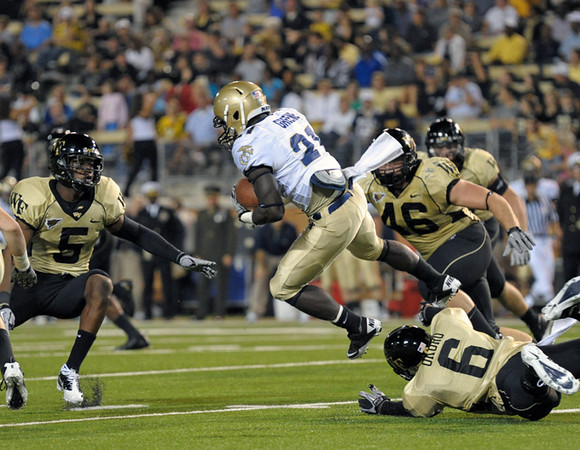 Kenny Okoro tackles Greene.jpg
