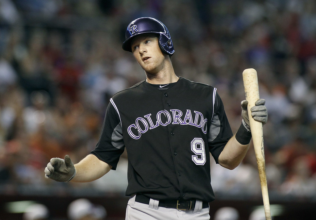 . D.J. LeMahieu #9 of the Colorado Rockies reacts after being called out on strikes against the Arizona Diamondbacks during the second inning of a MLB game at Chase Field on August 30, 2014 in Phoenix, Arizona. (Photo by Ralph Freso/Getty Images)