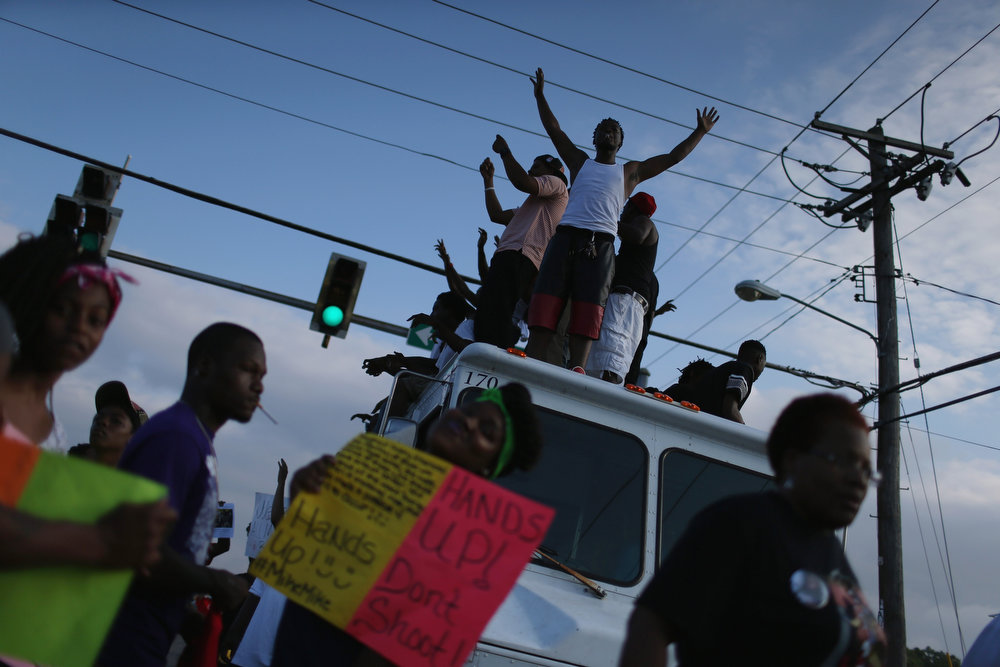 . Demonstrators protesting the shooting death of Michael Brown make their voices heard on August 17, 2014 in Ferguson, Missouri. Violent outbreaks have taken place in Ferguson since the shooting death of Michael Brown by a Ferguson police officer on August 9th.  (Photo by Joe Raedle/Getty Images)