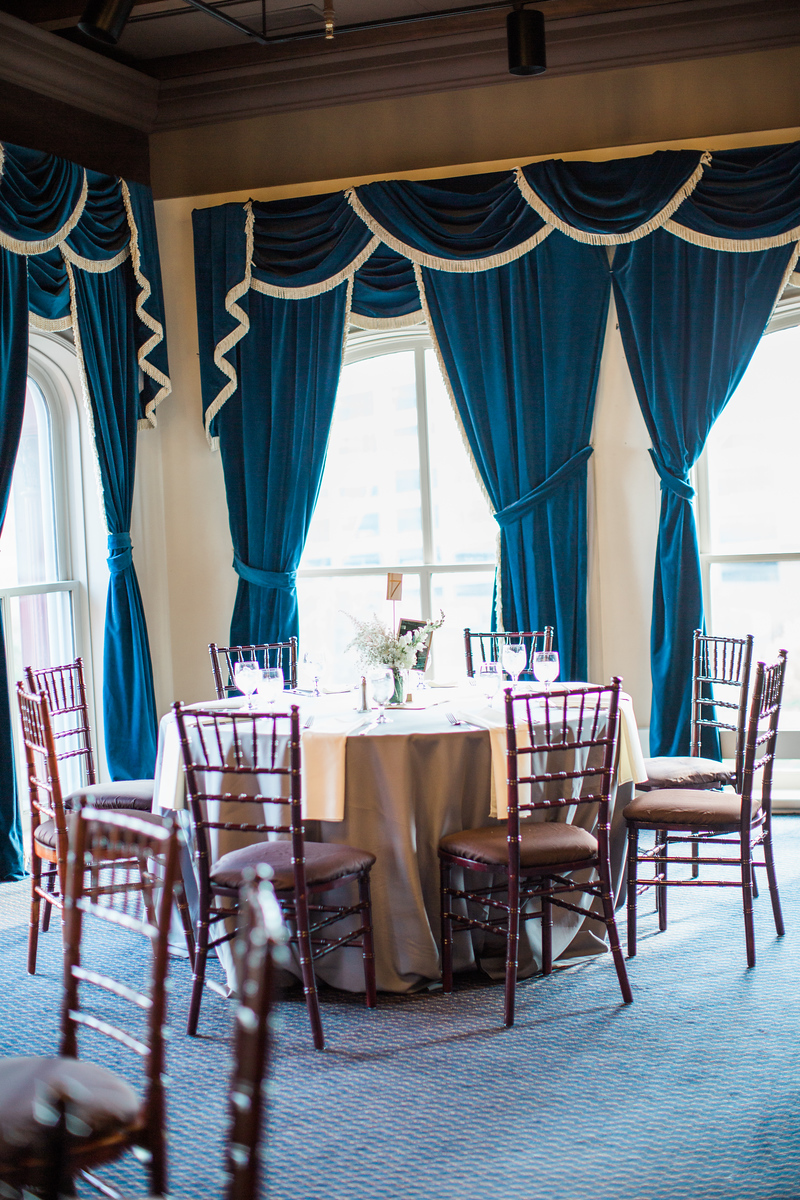 4th Floor ballroom of the 1840s Plaza. This Baltimore wedding venue features an historic building, navy and gold drapes, and a plethora of chandeliers. For more images by Baltimore's best wedding photographer Jalapeno Photography, see http://www.jalapenophotography.com