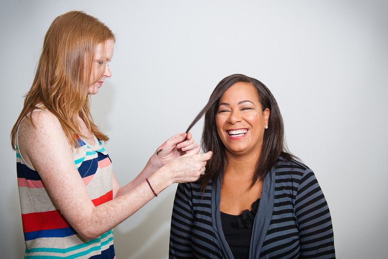 Hillary fixing Amanda's hair