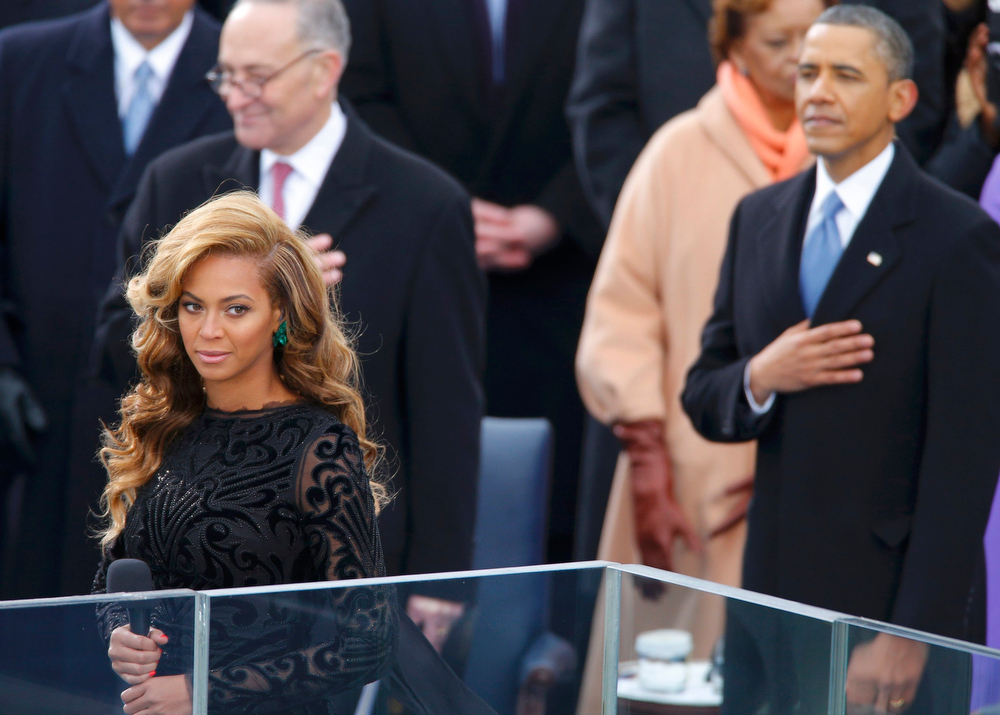 Description of . Beyonce starts singing the U.S. National Anthem as President Barack Obama (R) and Senator Charles Schumer (D-NY) listen during swearing-in ceremonies on the West front of the U.S Capitol in Washington, January 21, 2013. REUTERS/Jim Bourg