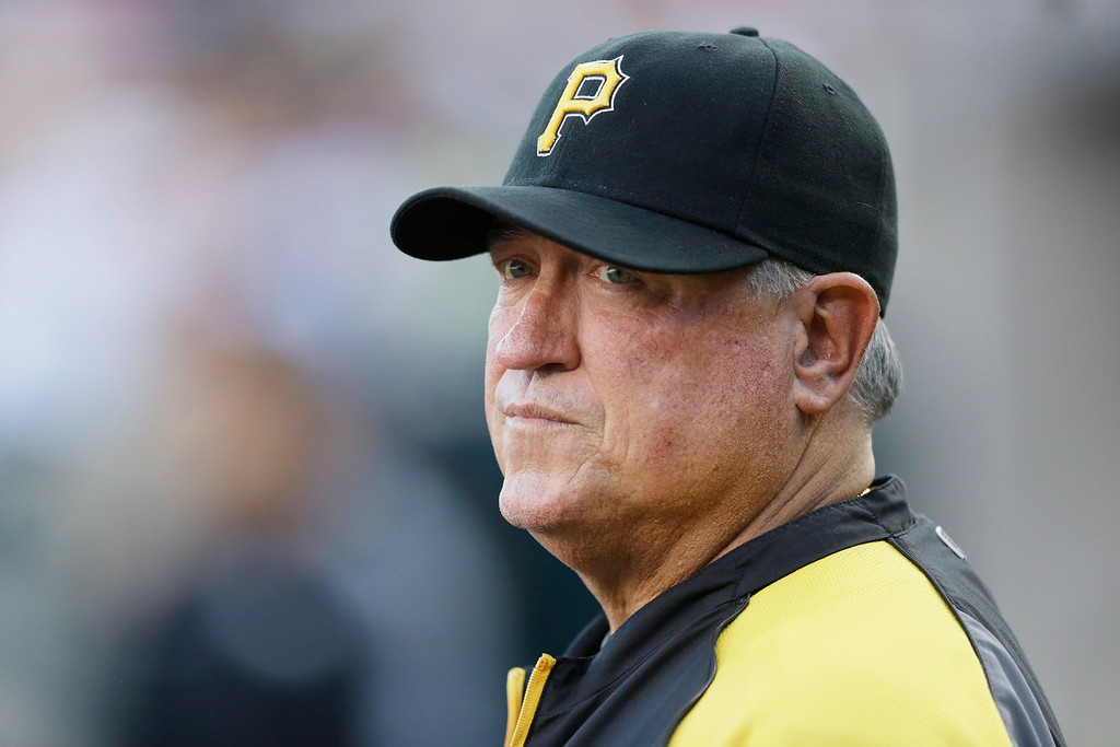 . Pittsburgh Pirates manager Clint Hurdle is seen in the dugout during the second inning of an interleague baseball game against the Detroit Tigers, Wednesday, Aug. 13, 2014 in Detroit. (AP Photo/Carlos Osorio)