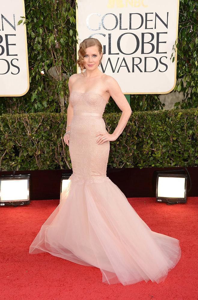 Description of . Actress Amy Adams arrives at the 70th Annual Golden Globe Awards held at The Beverly Hilton Hotel on January 13, 2013 in Beverly Hills, California.  (Photo by Jason Merritt/Getty Images)