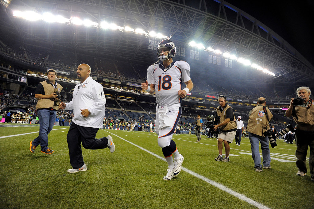 . SEATTLE, WA. - AUGUST 17: Denver Broncos quarterback Peyton Manning (18) runs off the field after the game August 17, 2013 at Century Link Field. The Seattle Seahawks defeated the Denver Broncos 40-10. (Photo By John Leyba/The Denver Post)
