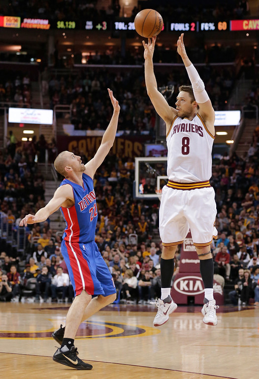 . Cleveland Cavaliers\' Matthew Dellavedova (8) shoots over Detroit Pistons\' Steve Blake (22) during the first half of an NBA basketball game Wednesday, April 13, 2016, in Cleveland. The Pistons won 112-110 in overtime. (AP Photo/Tony Dejak)