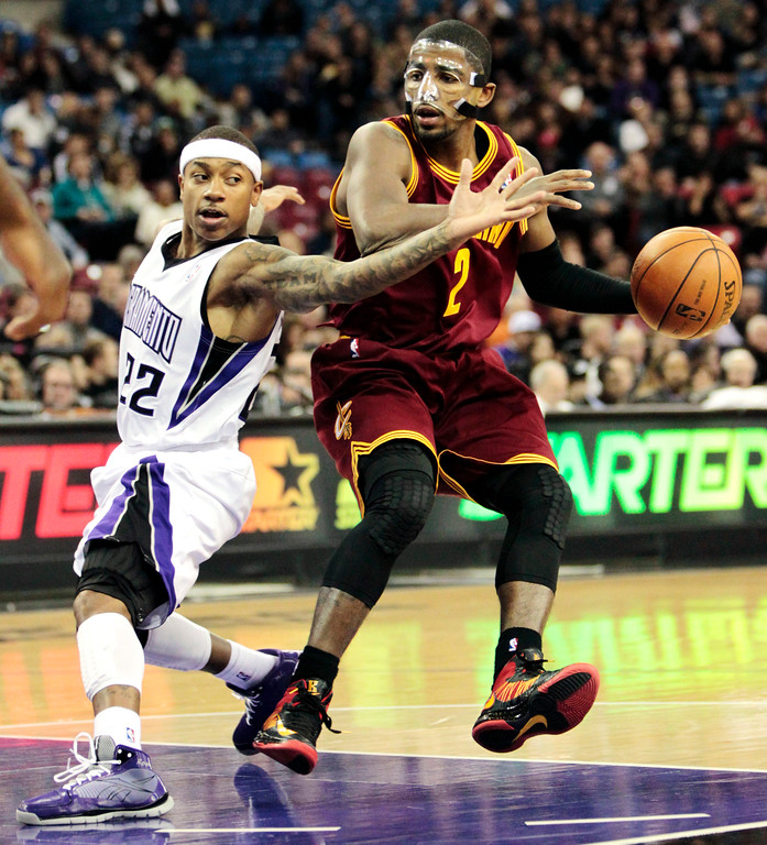 . Sacramento Kings guard Isaiah Thomas, left, defends against Cleveland Cavaliers guard Kyrie Irving during the first quarter of an NBA basketball game in Sacramento, Calif., Monday, Jan. 14, 2013. (AP Photo/Rich Pedroncelli)