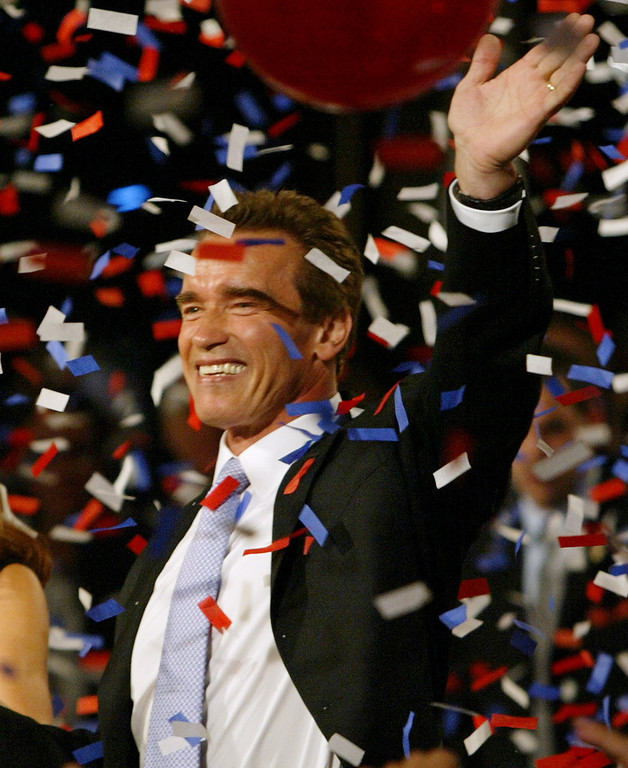 . Arnold Schwarzenegger celebrates his victory in the California gubernatorial recall election at his election night headquarters in Los Angeles, Tuesday, Oct. 7, 2003. (AP Photo/Chris Carlson)