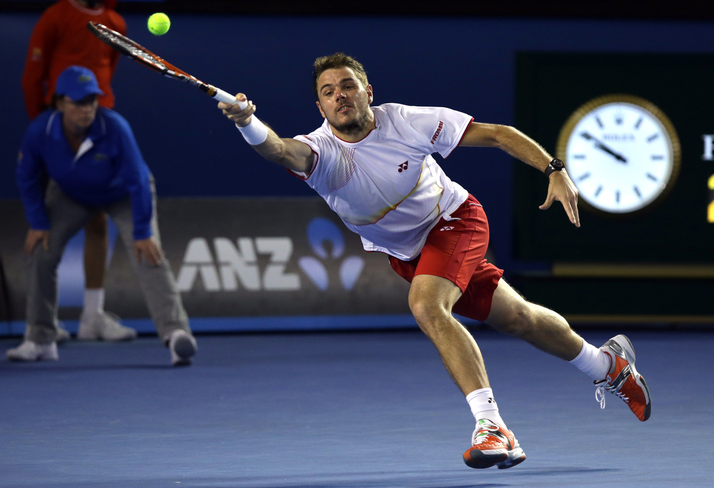 . Stanislas Wawrinka of Switzerland makes a forehand return to  Tomas Berdych of the Czech Republic during their semifinal at the Australian Open tennis championship in Melbourne, Australia, Thursday, Jan. 23, 2014.(AP Photo/Aaron Favila)