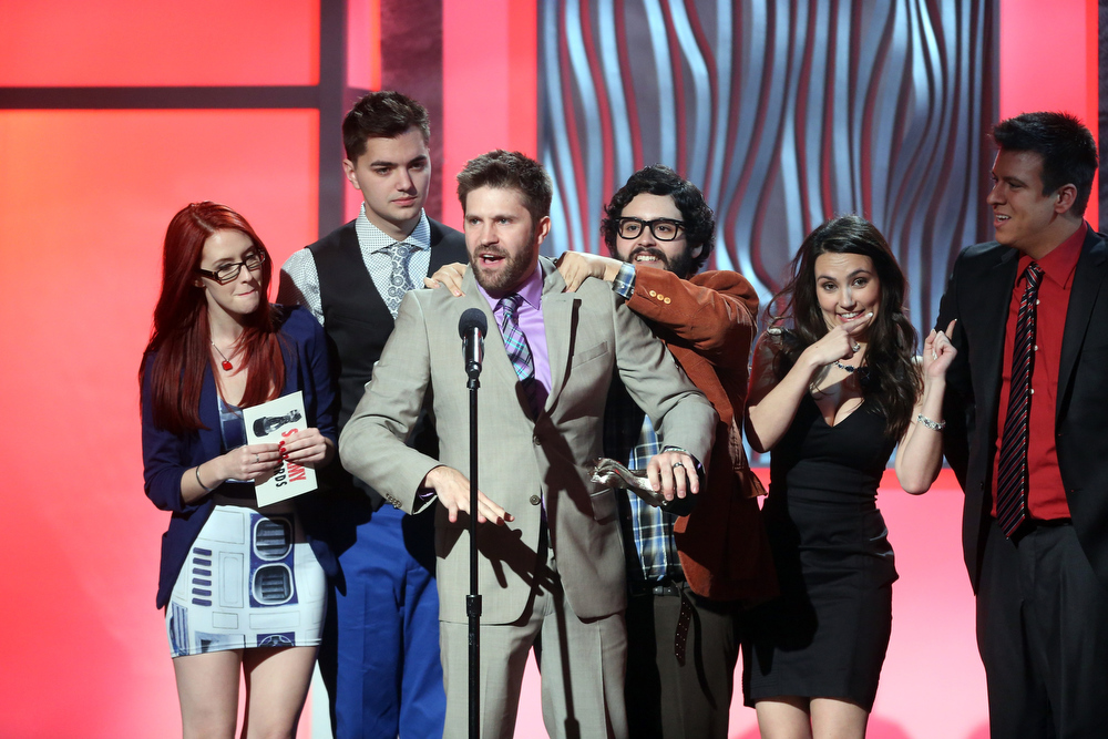 ". The cast of ""SourceFed\"" accept the Steamy Series of the Year award onstage at the 3rd Annual Streamy Awards at Hollywood Palladium on February 17, 2013 in Hollywood, California.  (Photo by Frederick M. Brown/Getty Images)"