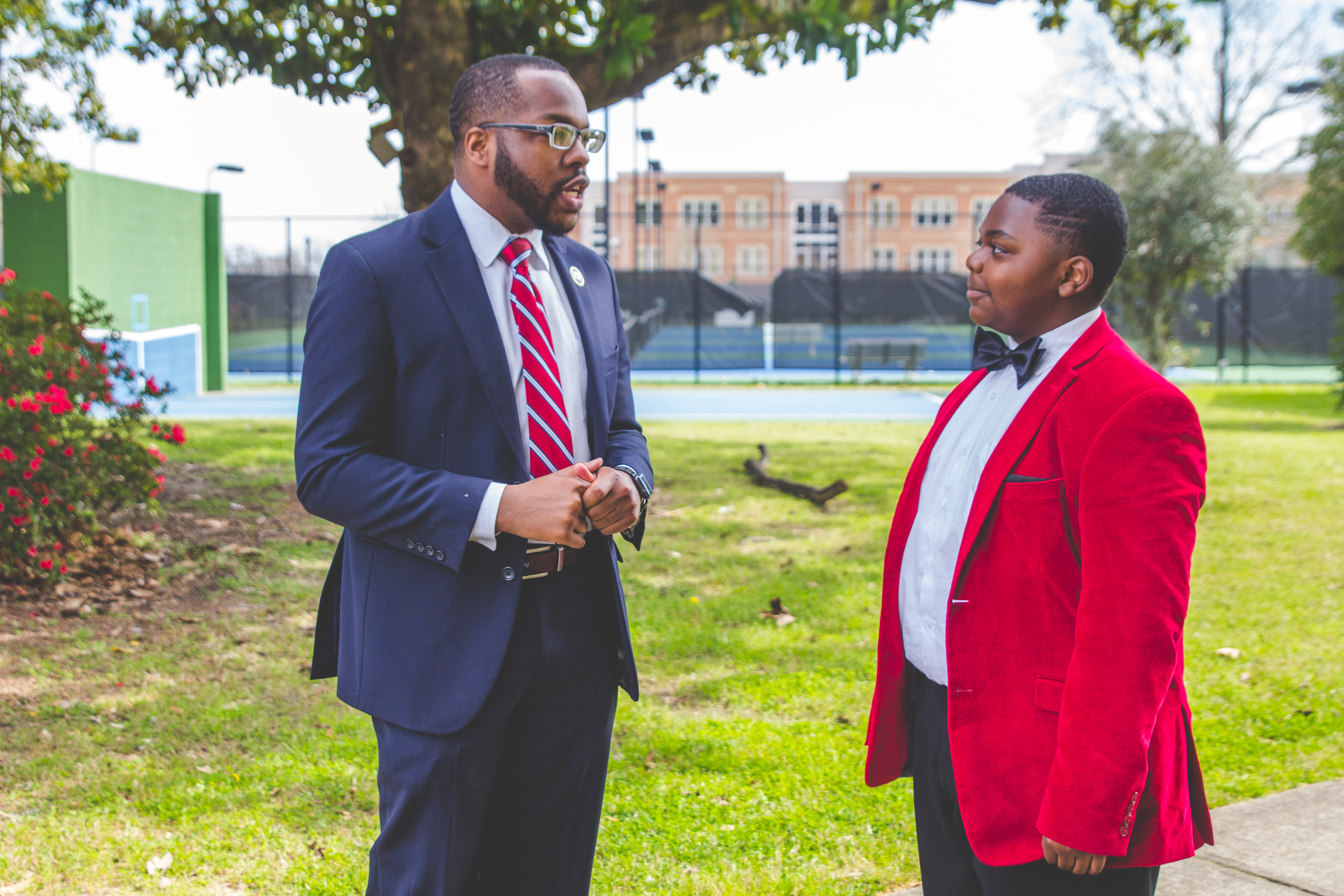 Juawn Jackson speaks with a local grade school student