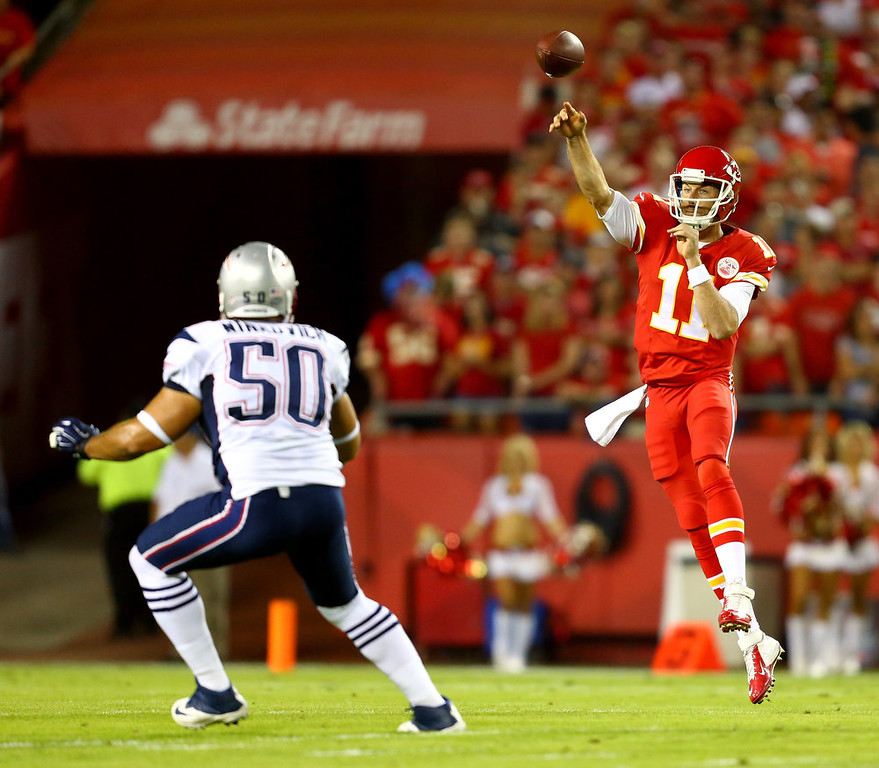 . Alex Smith #11 of the Kansas City Chiefs passes against  Rob Ninkovich #50 of the New England Patriots during the first quarter at Arrowhead Stadium on September 29, 2014 in Kansas City, Missouri.  (Photo by Dilip Vishwanat/Getty Images)