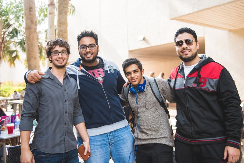 Zackary Alghamdy(left) Raken Alotaibi, Ali Alhuwayshil and Sameer Alotaibi catch up between classes.