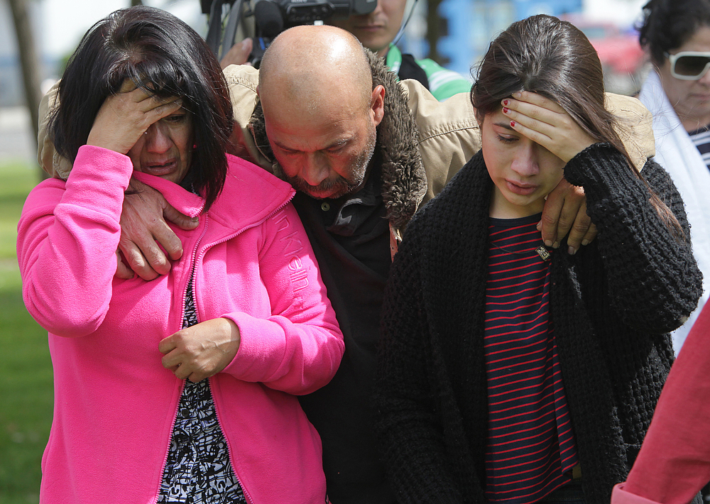 Description of . A family leaves the Red Cross shelter at Veterans Memorial Hall Friday, April 11, 2014, in Orland, Calif., after looking for their daughter who was involved in the fiery crash between a FedEx semi and a tour bus carrying Southern California students to Humboldt University on Thursday in I-5 near Orland. According to the Record Searchlight, the family hoped their daughter was at the shelter but she was not. (AP Photo/The Record Searchlight, Andreas Fuhrmann)