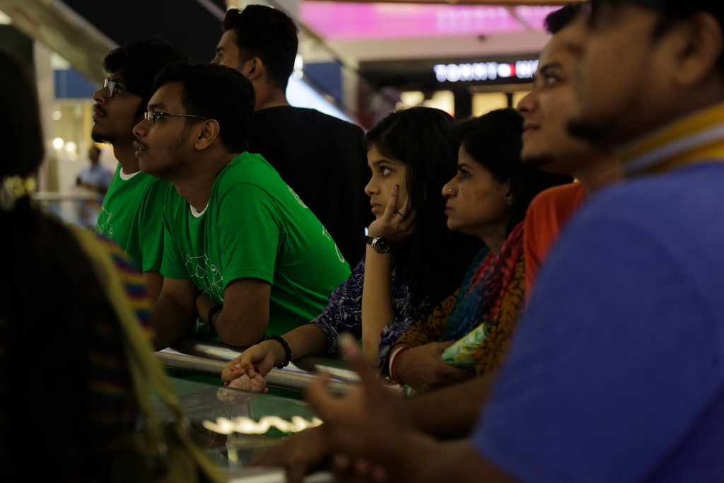 . Indians watch the world cup final match between France and Croatia in Kolkata, India, Sunday, July 15, 2018. (AP Photo/Bikas Das)
