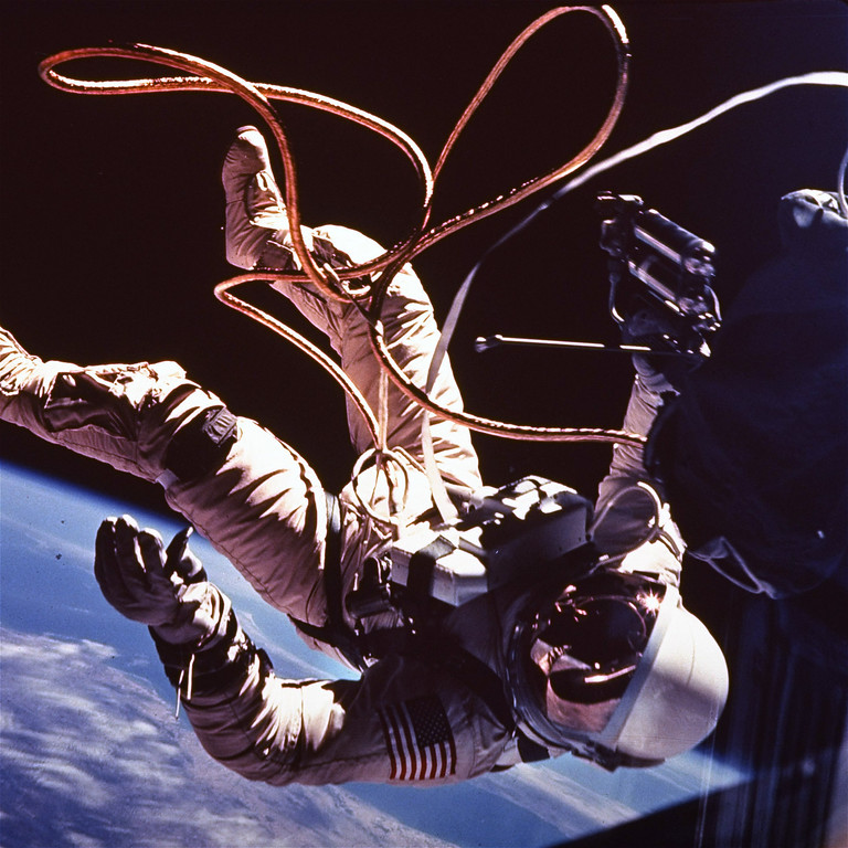 . Astronaut Ed White moves away from his Gemini 4 capsule as his golden tether unreels from a black bag in which it was kept until he emerged from the spacecraft.  He somersaulted away for most of the tether\'s length, then maneuvered back with the aid of an oxygen rocket gun.  This picture was made by White\'s fellow astronaut, James McDivitt, June 8, 1965, with a Hasselblad camera. (AP Photo/NASA)