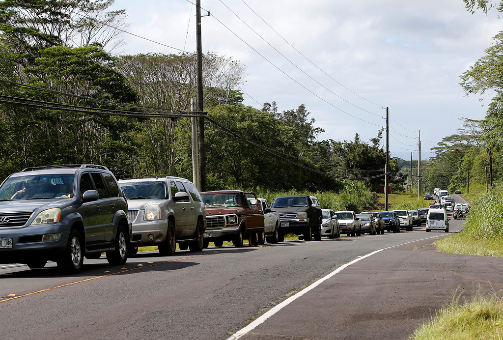 . Residents of the Leilani Estates queue in a line to enter the subdivision to gather possessions from their homes, Sunday, May 6, 2018, in Pahoa, Hawaii. Scientists reported lava spewing more than 200 feet (61 meters) into the air in Hawaii\'s recent Kilauea volcanic eruption, and some of the more than 1,700 people who evacuated prepared for the possibility they may not return for quite some time. (AP Photo/Marco Garcia)