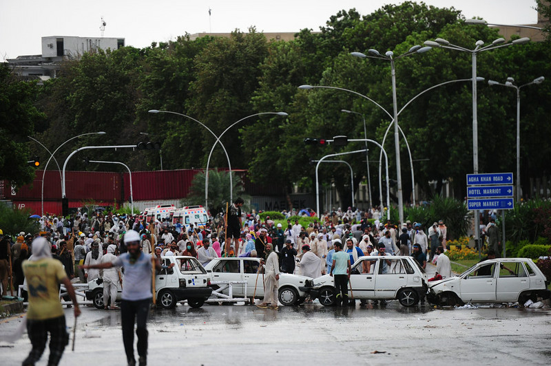 . Pakistani opposition protesters gather during clashes with police near the prime minister\'s residence in Islamabad on September 1, 2014. Anti-government protesters armed with rocks and wooden clubs clashed with police in Islamabad September 1, hours after the powerful army called for a peaceful resolution to the political crisis rocking Pakistan. ASIF HASSAN/AFP/Getty Images