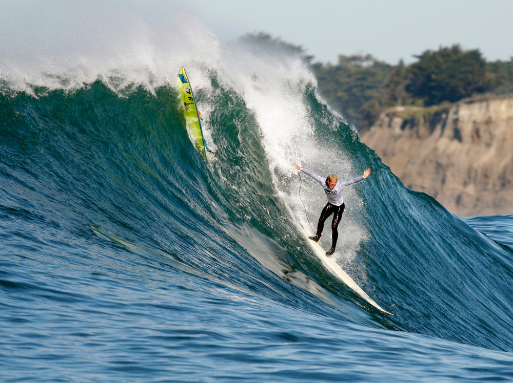 Description of . Dave Wassel drops in on a wave during Round One of the Mavericks Invitational surf contest Sunday, Jan. 20, 2013 at  Princeton by the Sea, Calif. (Karl Mondon/Staff)