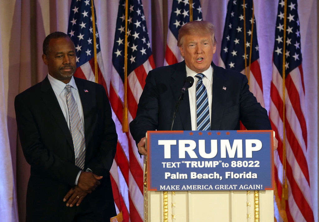 . Republican presidential candidate Donald Trump,speaks during a news conference at the Mar-A-Lago Club as Former Republican presidential candidate Ben Carson, left, looks on, Friday, March 11, 2016, in Palm Beach, Fla. Carson endorsed Trump in the presidential race. (AP Photo/Lynne Sladky)