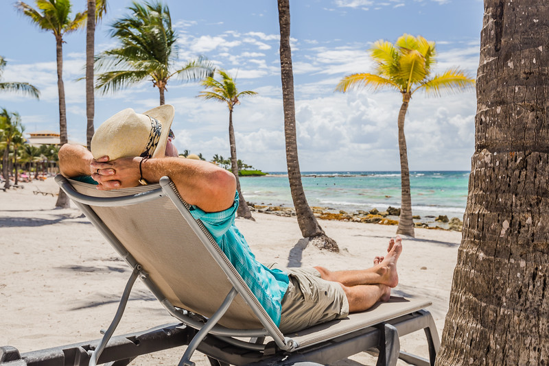 David Stock sitting in a beach chair in Mexico