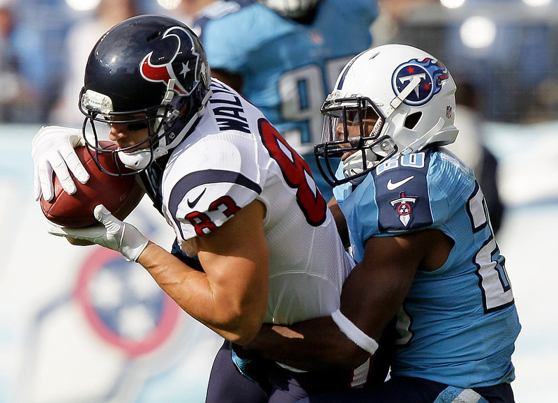 . Houston Texans wide receiver Kevin Walter (83) is pulled down by Tennessee Titans defensive back Alterraun Verner (20) in the first quarter of an NFL football game on Sunday, Dec. 2, 2012, in Nashville, Tenn. (AP Photo/Wade Payne)