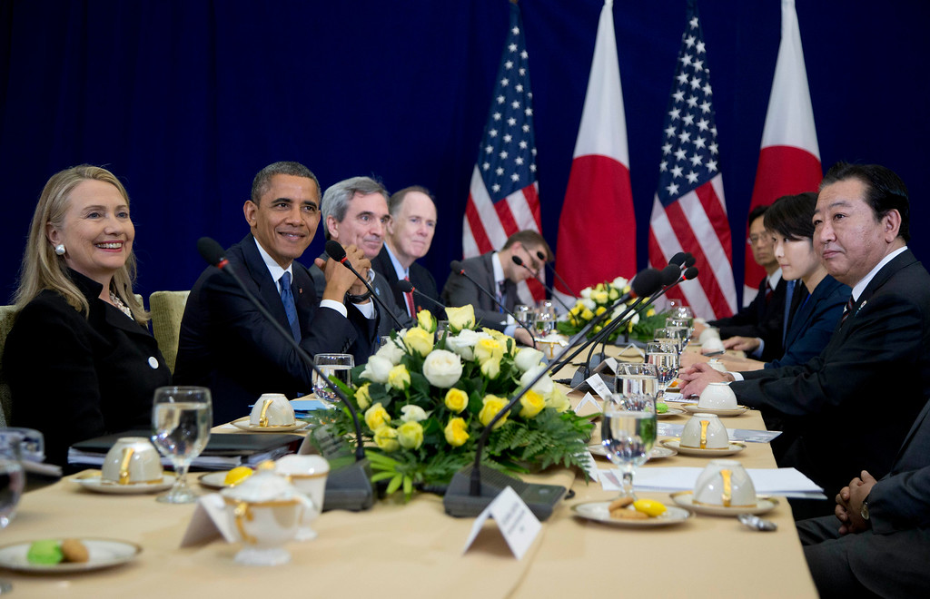 . U.S. President Barack Obama, second from left, smiles as he meets with Japan\'s Prime Minister Yoshihiko Noda, right, during the East Asia Summit at the Peace Palace in Phnom Penh, Cambodia, Tuesday, Nov. 20, 2012. Smiling at left is U.S. Secretary of State Hillary Rodham Clinton. (AP Photo/Carolyn Kaster)