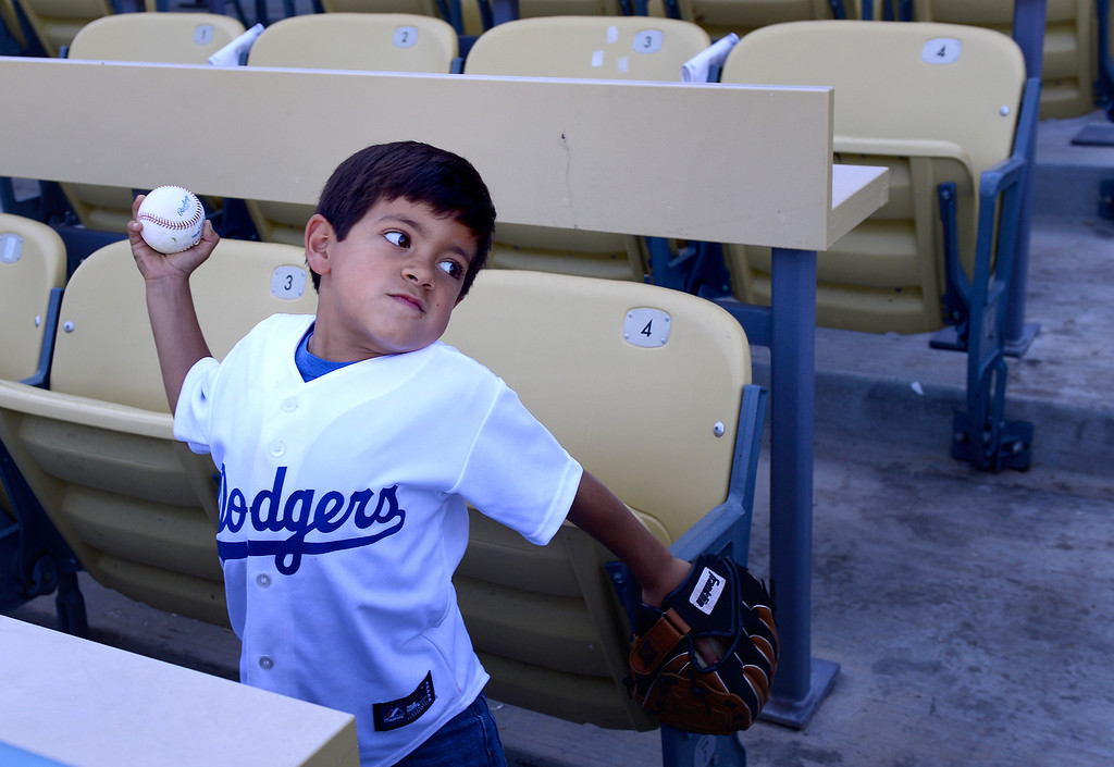 . Andrew Benavidez, 7, of Covina, plays ball with his brother Nathan before the Dodgers vs Brave\'s game 3 of the NLDS at Dodger Stadium, Sunday, October 6, 2013. (Photo by Sarah Reingewirtz/Los Angeles Daily News)