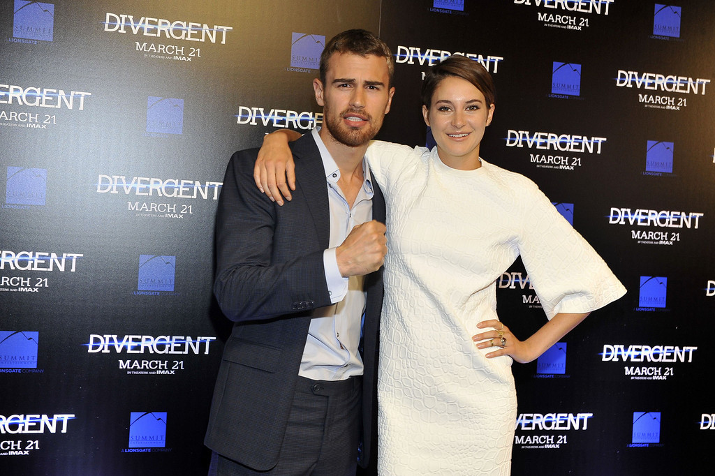 """. (L-R) Shailene Woodley and actor Theo James attend the \""""Divergent\"""" screening at Regal Atlantic Station on March 3, 2014 in Atlanta, Georgia. (Photo by Moses Robinson/Getty Images)"""
