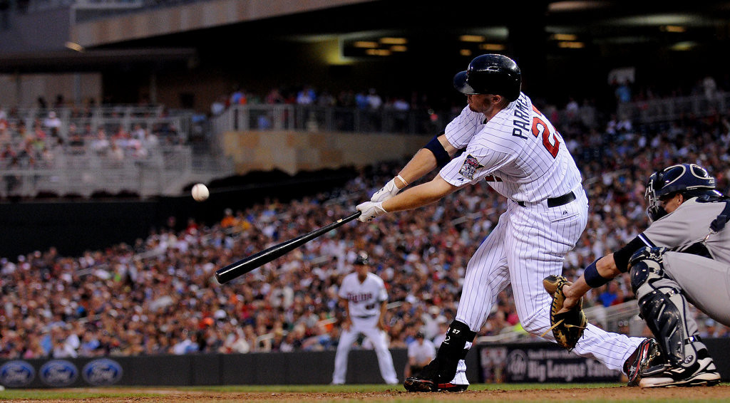 . Minnesota right fielder Chris Parmelee hits a solo home run off New York starting pitcher Andy Pettitte during the sixth inning. (Pioneer Press: John Autey)