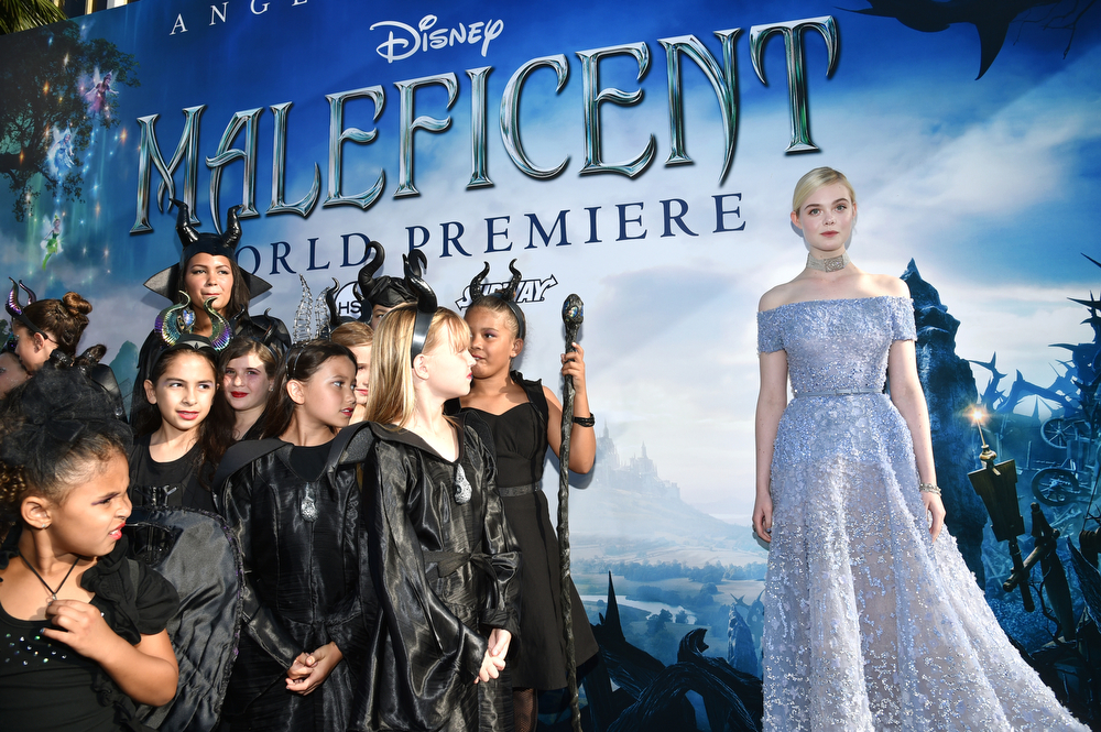 """. Elle Fanning arrives at the world premiere of \""""Maleficent\"""" at the El Capitan Theatre on Wednesday, May 28, 2014, in Los Angeles. (Photo by John Shearer/Invision/AP)"""