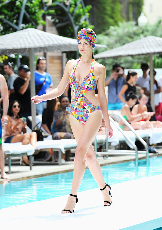 . A model walks the runway at the Gottex show during Mercedes-Benz Fashion Week Swim 2014 at the SLS Hotel on July 21, 2013 in Miami, Florida.  (Photo by Serg Alexander/Getty Images for Mercedes-Benz Fashion Week Swim 2014)