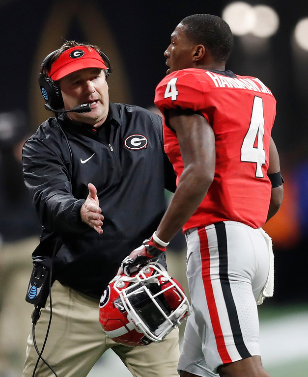 . Georgia head coach Kirby Smart congratulates Mecole Hardman after a touchdown run during the first half of the NCAA college football playoff championship game against Alabama Monday, Jan. 8, 2018, in Atlanta. (AP Photo/David Goldman)