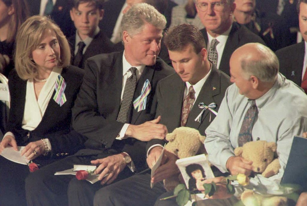 . OKLAHOMA CITY, OK - APRIL 23:  US President Bill Clinton(2nd L) and First Lady Hillary(L) sit with Jason Smith(2nd R), whose mother is missing in the 19 April bomb attack on the federal buidling in Oklahoma City, and Don McKinney(R), whose wife is missing in the attack, during a prayer service for the families of the bombing at the Oklahoma City State Fair Arena 23 April.      (J. DAVID AKE/AFP/Getty Images)