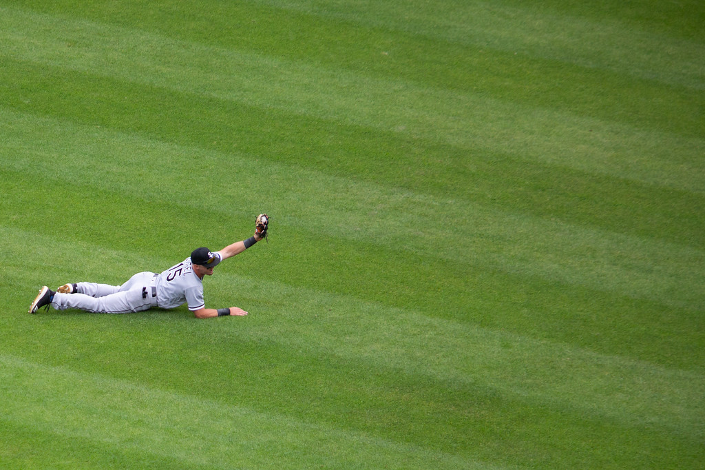 . Adam Engel of the Chicago White Sox holds up the ball after making a diving catch in the outfield during a regular season game at Progressive Field on June 20, 2018. The Indians defeated the Sox 12-0. (The Morning Journal/Michael Johnson)