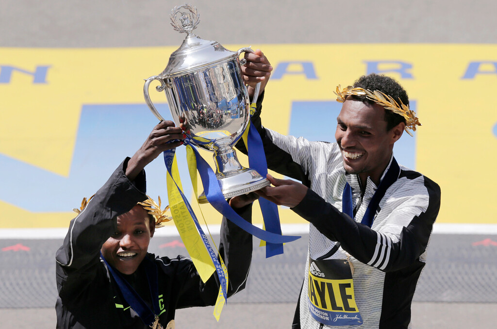 . Atsede Baysa, left, and Lemi Berhanu Hayle, both of Ethiopia, hold a trophy after they won the women\'s and men\'s divisions of the 120th Boston Marathon on Monday, April 18, 2016, in Boston. (AP Photo/Charles Krupa)