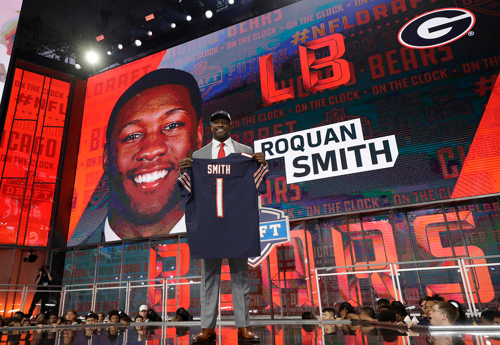. Georgia\'s Roquan Smith poses with his Chicago Bears jersey after being selected by the team during the first round of the NFL football draft, Thursday, April 26, 2018, in Arlington, Texas. (AP Photo/David J. Phillip)