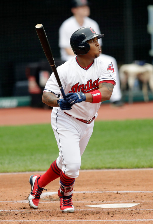 . Cleveland Indians\' Jose Ramirez watches his ball after hitting a three-run home run off Chicago White Sox starting pitcher Reynaldo Lopez in the first inning of a baseball game, Wednesday, June 20, 2018, in Cleveland. Francisco Lindor and Michael Brantley scored on the play. (AP Photo/Tony Dejak)