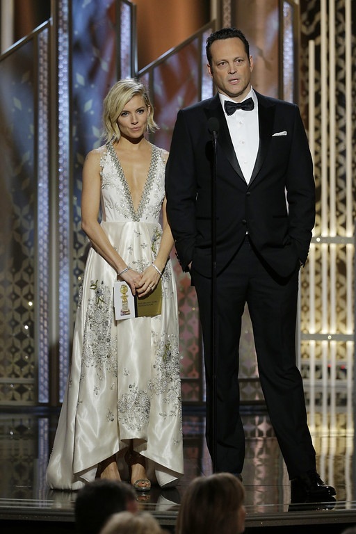 . BEVERLY HILLS, CA - JANUARY 11:  In this handout photo provided by NBCUniversal,  Presenters Sienna Miller and Vince Vaughn speak onstage during the 72nd Annual Golden Globe Awards at The Beverly Hilton Hotel on January 11, 2015 in Beverly Hills, California.  (Photo by Paul Drinkwater/NBCUniversal via Getty Images)