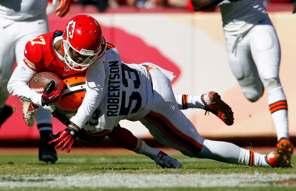 . Kansas City Chiefs wide receiver Donnie Avery (17) is tackled by Cleveland Browns inside linebacker Craig Robertson (53) during the second half of an NFL football game in Kansas City, Mo., Sunday, Oct. 27, 2013. (AP Photo/Colin E. Braley)