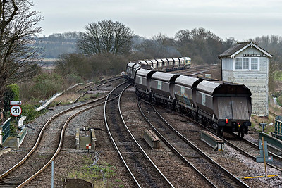 Freightliner 66607 snakes across the track at east end of Barnetby towards Immingham