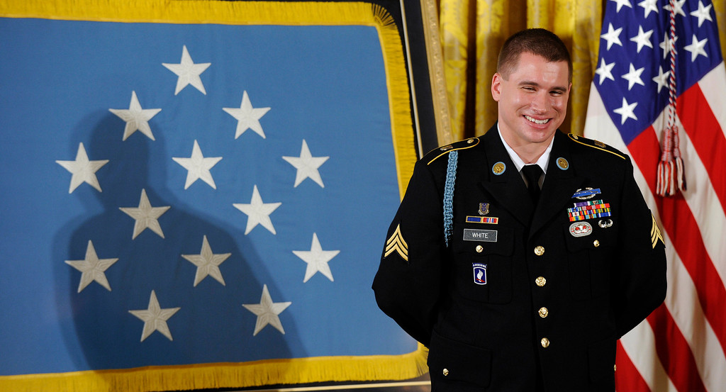 . Former Army Sgt. Kyle J. White smiles as President Barack Obama talks about him before he was awarded the Medal of Honor during a ceremony in the East Room of the White House in Washington, Tuesday, May 13, 2014. White is a former Army sergeant who saved a fellow soldier\'s life and helped secure the evacuation of other wounded Americans while under persistent fire during a 2007 ambush in Afghanistan. White is the seventh living recipient to be awarded the Medal of Honor for actions in Iraq or Afghanistan. (AP Photo)