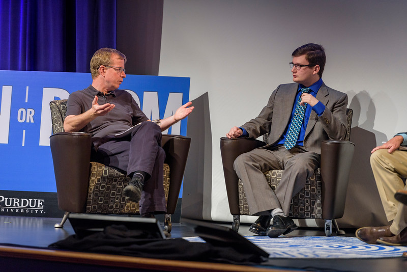 Quentin Hardy, head editor of Google, and Brad Pushkar, editor-in-chief of the Purdue Exponent, speak on a panel during the second day of the Dawn Or Doom conference in Fowler Hall. (Purdue University Photo/Alex Kumar)