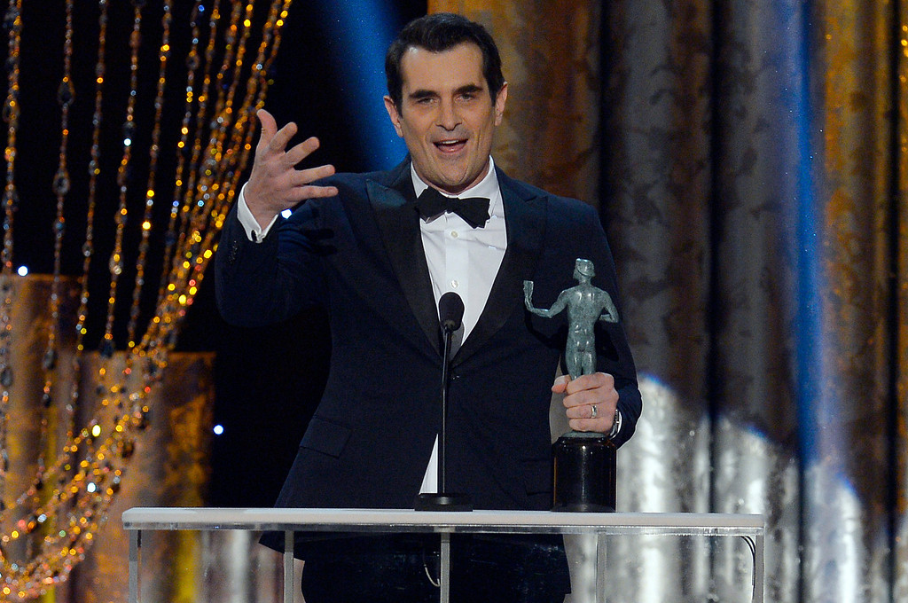 . Ty Burrell accepts for  Outstanding Performance by a Male Actor in a Comedy Series during the show of the 20th Annual Screen Actors Guild Awards  at the Shrine Auditorium in Los Angeles, California on Saturday January 18, 2014 (Photo by Andy Holzman / Los Angeles Daily News)