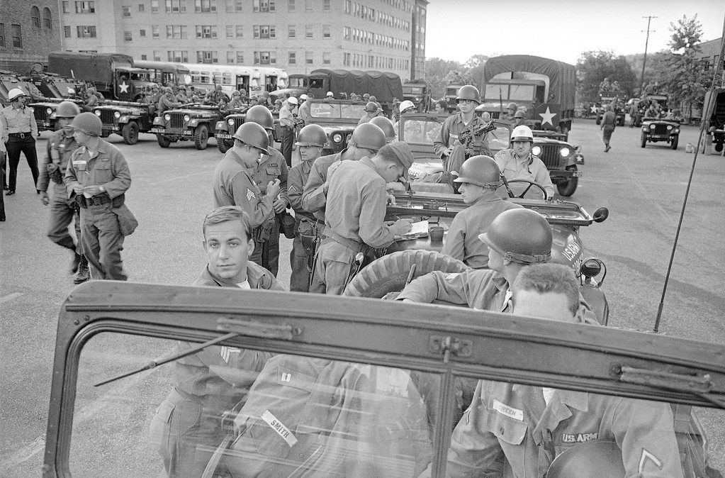 . Ohio National Guard are ready to move from marshaling area into their assigned sections of Cleveland in a continued attempt to maintain law and order in the riot torn city, July 21, 1966. (AP Photo)