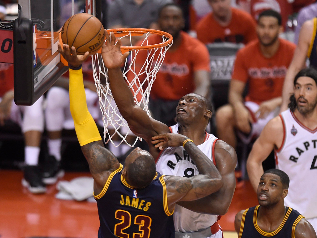 . Toronto Raptors center-forward Bismack Biyombo, center right, picks up a foul as he stops Cleveland Cavaliers forward LeBron James during the second half of Game 3 of the Eastern Conference finals in Toronto on May 21. James led the Cavs in points, assists and rebounds, with 24, 5 and 8, respectively, in the team\'s 99-84 loss. Cleveland leads the series, 2-1.(Frank Gunn/The Canadian Press via AP)